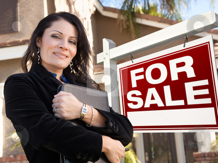 Female Hispanic Real Estate Agent, For Sale Real Esate Sign and  stock photo, Proud, Attractive Hispanic Female Agent In Front of For Sale Real Estate Sign and House. by Andy Dean