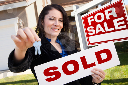 Hispanic Woman Holding Sold Real Estate Sign and Keys in Front H stock photo, Happy Attractive Hispanic Woman Holding Sold Real Estate Sign and Keys in Front For Sale Real Estate Sign and House. by Andy Dean