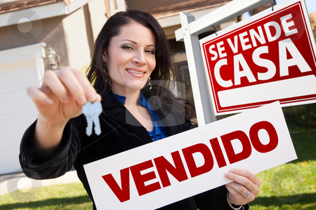 Hispanic Woman Holding Vendido Sign in Front of Se Vende Casa Si stock photo, Happy Attractive Hispanic Woman Holding Vendido Real Estate Sign and Keys in Front Se Vende Casa Real Estate Sign and House. by Andy Dean