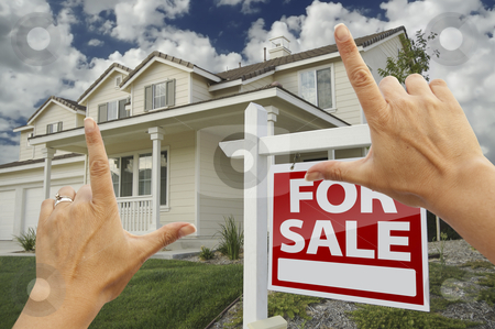Hands Framing For Sale Real Estate Sign and New House stock photo, Female Hands Framing Home For Sale Real Estate Sign in Front of New House. by Andy Dean