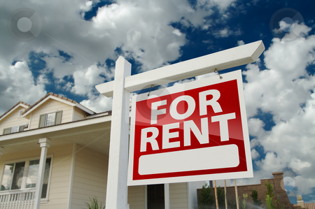 For Rent Real Estate Sign in Front of House stock photo, Left Facing Red For Rent Real Estate Sign in Front of Beautiful House. by Andy Dean