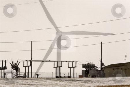 Windmill electrical generator by power station stock photo, Windmill electrical generator by power station by Mark Duffy