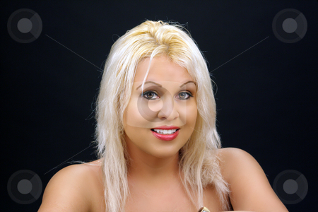 Beautiful Blonde Headshot (1) stock photo, A studio close-up of a lovely young platinum-blonde model. by Carl Stewart