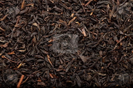 Black tea background stock photo, some dried and fermented black tea leaves forming a background pattern by Jerax
