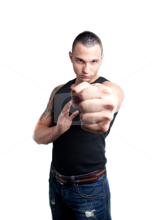 Young man fist stock photo, a young man pointing with his fist to the viewer by Jerax