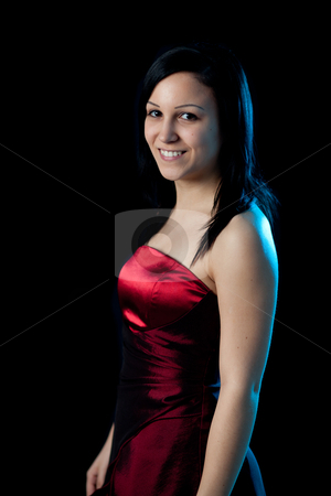 Young womand portrait blue light stock photo, portrait of a young woman in a red dress lit by blue backlight by Jerax