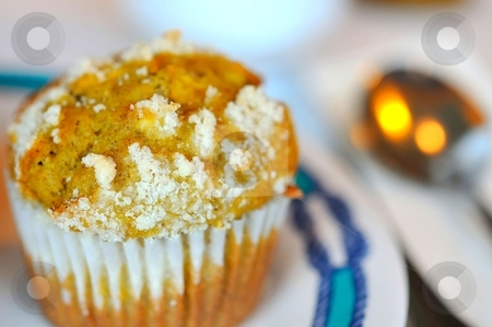 Coconut muffin for snack stock photo, Coconut cupcake on white plate with utensils. by Wai Chung Tang