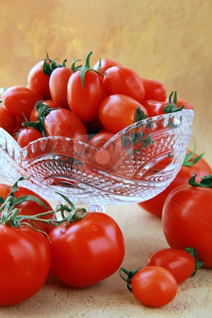 Different varieties of tomatoes in a crystal vase stock photo, different varieties of tomatoes in a crystal vase by Olga Kriger