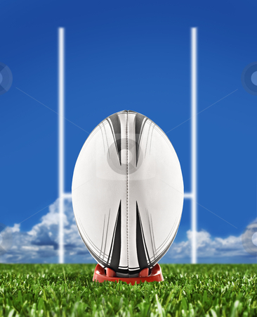 Rugby ball on field with goal posts stock photo, Rugby ball on field with goal posts by tish1