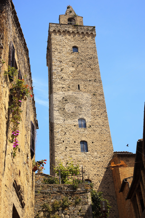 Medieval Stone Cuganensi Tower Flowers San Gimignano Tuscany Ita stock photo, Medieval Stone Ancient Cuganensi Tower Flowers San Gimignano Tuscany Italy by William Perry