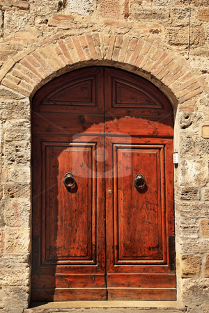 Ancient Brown Door Stone Doorway Medieval Town San Gimignano Tus stock photo, Ancient Brown Door Stone Doorway Medieval Town San Gimignano Tuscany Italy by William Perry
