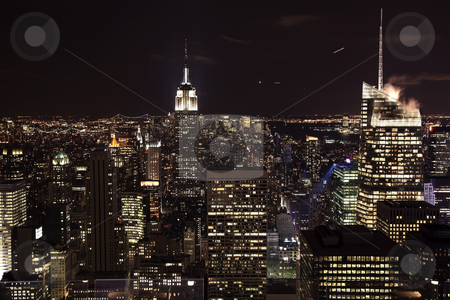 New York City Skyline East River Empire State Building Night stock photo, New York City Skyline East River Empire State Building Night Moon Airplanes by William Perry