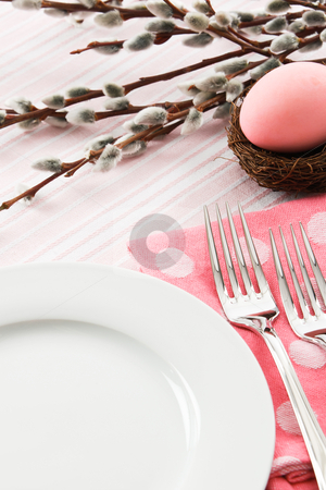 Easter Place Setting stock photo, A pastel pink place setting is decorated for an Easter meal leaving ample copy space over a white plate. by Karen Sarraga
