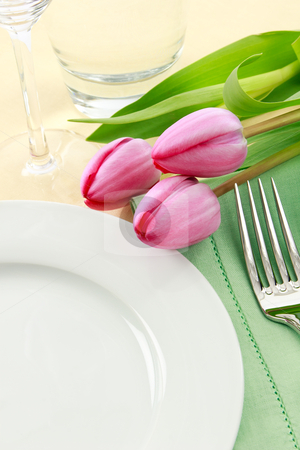 Spring Table Setting stock photo, Three pink tulips grace a table setting in fresh Spring colors making a perfect background for Easter or Mother's Day promotions - ample copy space provided with the empty white plate by Karen Sarraga