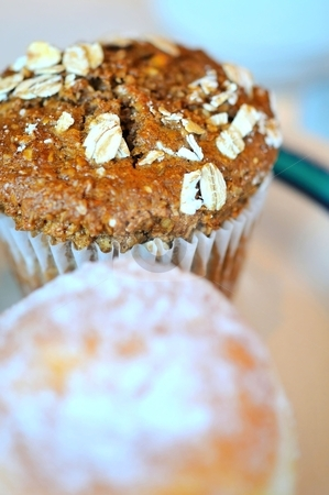 Brown cupcake with oat toppings stock photo, Brown cupcake with oat toppings for a nutritious snack. by Wai Chung Tang