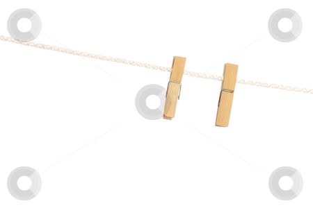 Clothespin stock photo, Clothespin on line isolated on white background by Piotr_Marcinski