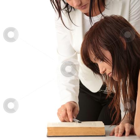 Teacher and student stock photo, Teacher Helping teen Student One on One. Shot in studio over white. by Piotr_Marcinski