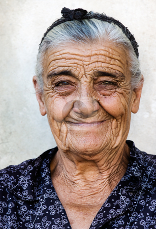 Happy old lady stock photo, Image shows a happy old lady from a village in Greece by Andreas Karelias