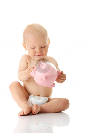 Young baby boy playing with pink piggy bank stock photo, Young baby boy playing with pink piggy bank isolated by Piotr_Marcinski