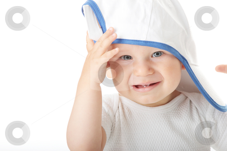 Baby trying on basebal cap stock photo, Adorable baby trying on basebal cap that is way too big for him  by Piotr_Marcinski