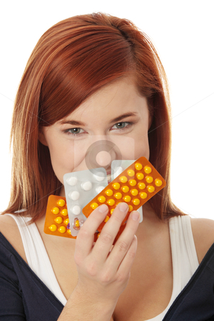 Young woman with pills stock photo, Young woman with pills isolated by Piotr_Marcinski