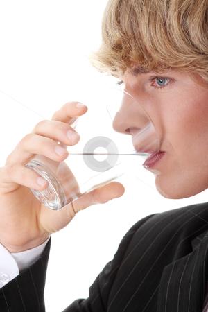 Businessman with glass of water stock photo, Businessman with glass of water, isolated on white  by Piotr_Marcinski