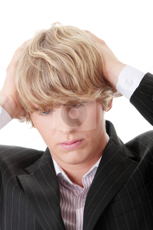 Businessman with a big headache  stock photo, Young businessman with a big headache  by Piotr_Marcinski