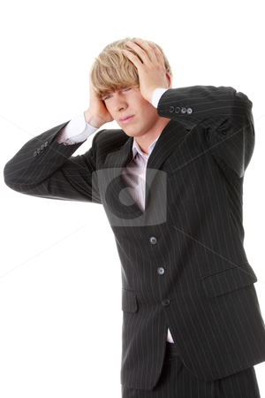Businessman with a big headache  stock photo, Young businessman with a big headache  by Piotr_Marcinski