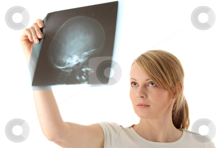 X-ray photo scan stock photo, Female doctor examining a haed x-ray photo scan. Isolated on white  by Piotr_Marcinski