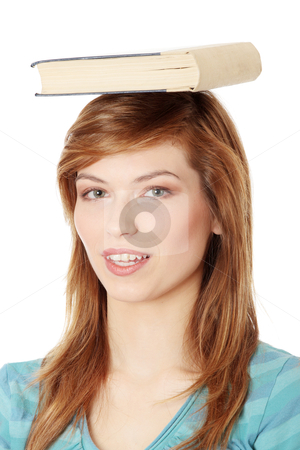 Student with book on her head stock photo, Young caucasian woman (student) with book on her head by Piotr_Marcinski