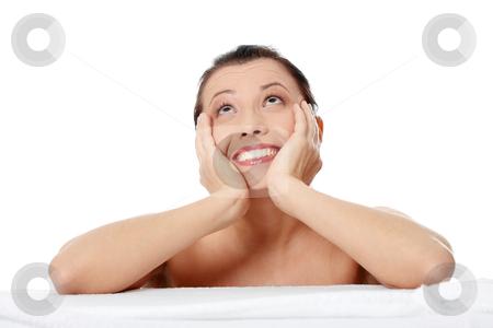 Amazed beautiful caucasian woman after bath stock photo, Young amazed beautiful caucasian woman after bath isolated on white  by Piotr_Marcinski