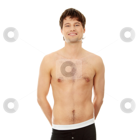 Handsome happy young man stock photo, Handsome happy young man in underwear. Isolated on white  by Piotr_Marcinski