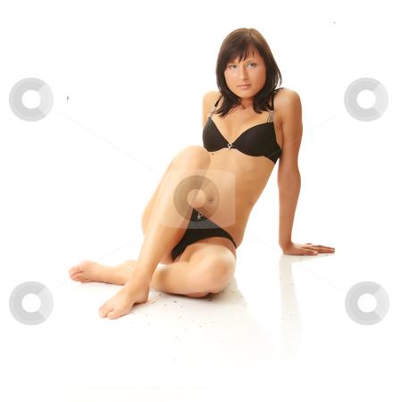 Beautiful female body in black lingerie stock photo, Beautiful female body in black lingerie isolated by Piotr_Marcinski
