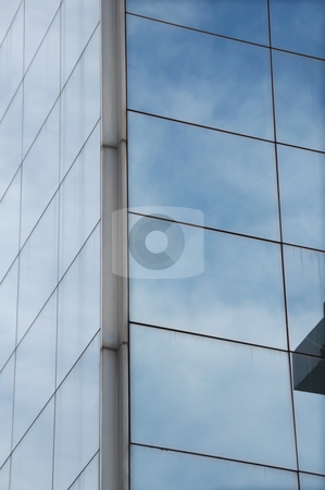 Mirrored sky stock photo, Sky mirrored on the windows of a modern glass building. Architectural detail. by sirylok