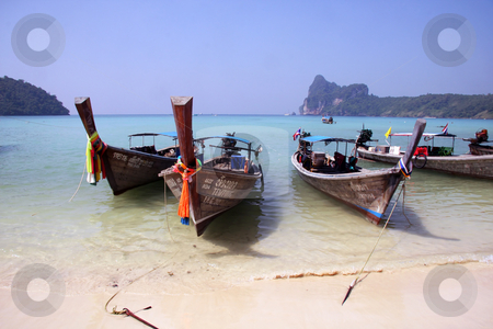 Thailand,phiphi island stock photo, Small boats in Thailand phiphi island. Blue sky and sea by Ingvar Bjork