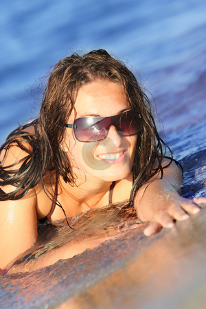 Young woman at beach  stock photo, Young woman at beach in the sea by vladacanon1