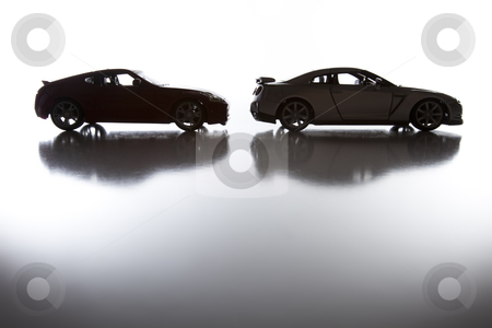 Silhouette of Sports Cars on Reflective Surface  stock photo, Silhouette of Sports Cars on Reflective Surface Against a White Background. by Andy Dean
