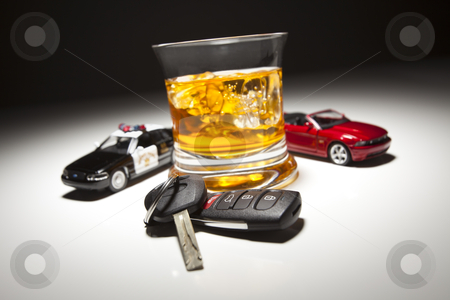 Highway Patrol Police and Sports Car Next to Alcoholic Drink and stock photo, Highway Patrol Police and Sports Car Next to Alcoholic Drink and Keys Under Spot Light. by Andy Dean