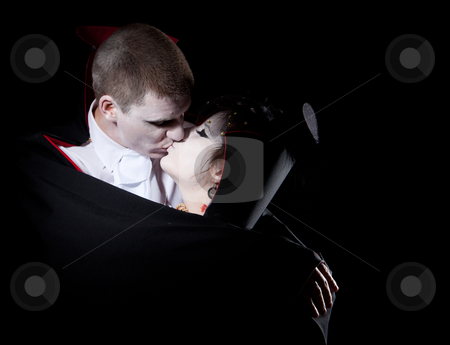 Vampire couple kiss stock photo, a vampire couple holding each other and kissing by Jerax