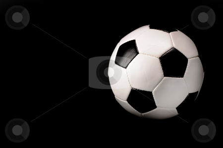 Soccer Ball stock photo, Soccer ball on black background with room for your type. by WScott