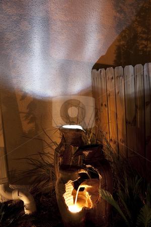 Broken Pot Fountain stock photo, A broken pot fountain shinning at night by Kevin Tietz