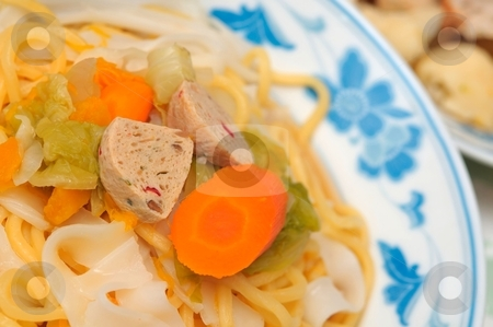 Closeup of noodle delicacy stock photo, Oriental style noodle delicacy served with healthy vegetarian ingredients. by Wai Chung Tang