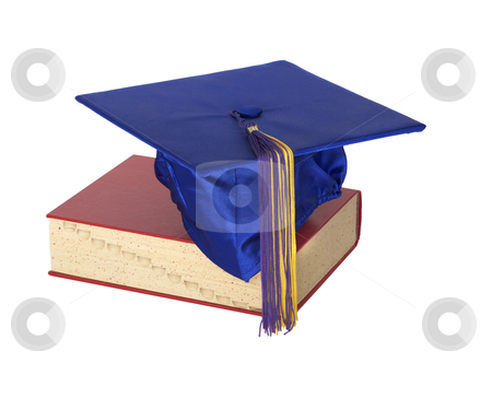 Graduate Hat on Book stock photo, A colorful graduation cap resting on top of a text book. by David Schliepp