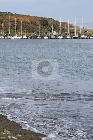 Sailboats at pier stock photo, Sailboats at a pier on a sunny day by Olena Pupirina