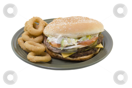 Double cheeseburger onion rings stock photo, double stack cheeseburger with tomato, lettuce, onions, mayo, pickles and onion rings on a green plate isolated on white by Lee Barnwell