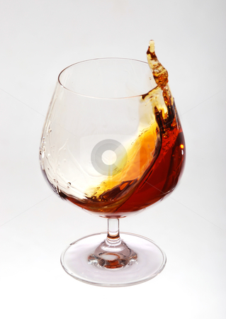 Glass of cognac stock photo, Glass of cognac over white background by sutike