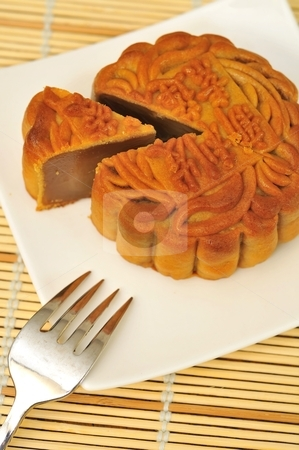 Single piece of oriental pie stock photo, Single slice of oriental pie on white plate. Popular for its sweet lotus paste filling. by Wai Chung Tang
