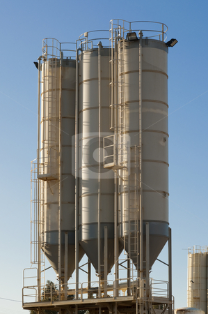 Three silos stock photo, three silos of sand in a gravel pit operation by paulrommer