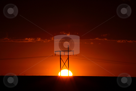 Gorgeous sunset behind Saskatchewan power towers stock photo, Gorgeous sunset behind Saskatchewan power towers by Mark Duffy