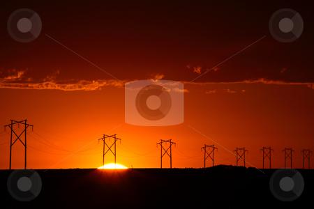 Gorgeous sunset behind Saskatchewan power towers stock photo, Gorgeous sunset behind Saskatchewan power towers by Mark Duffy